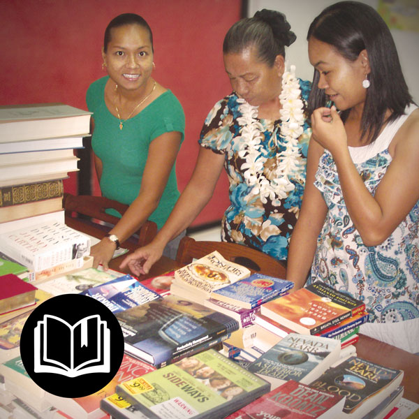Local women sampling the donated books at the library in Rota